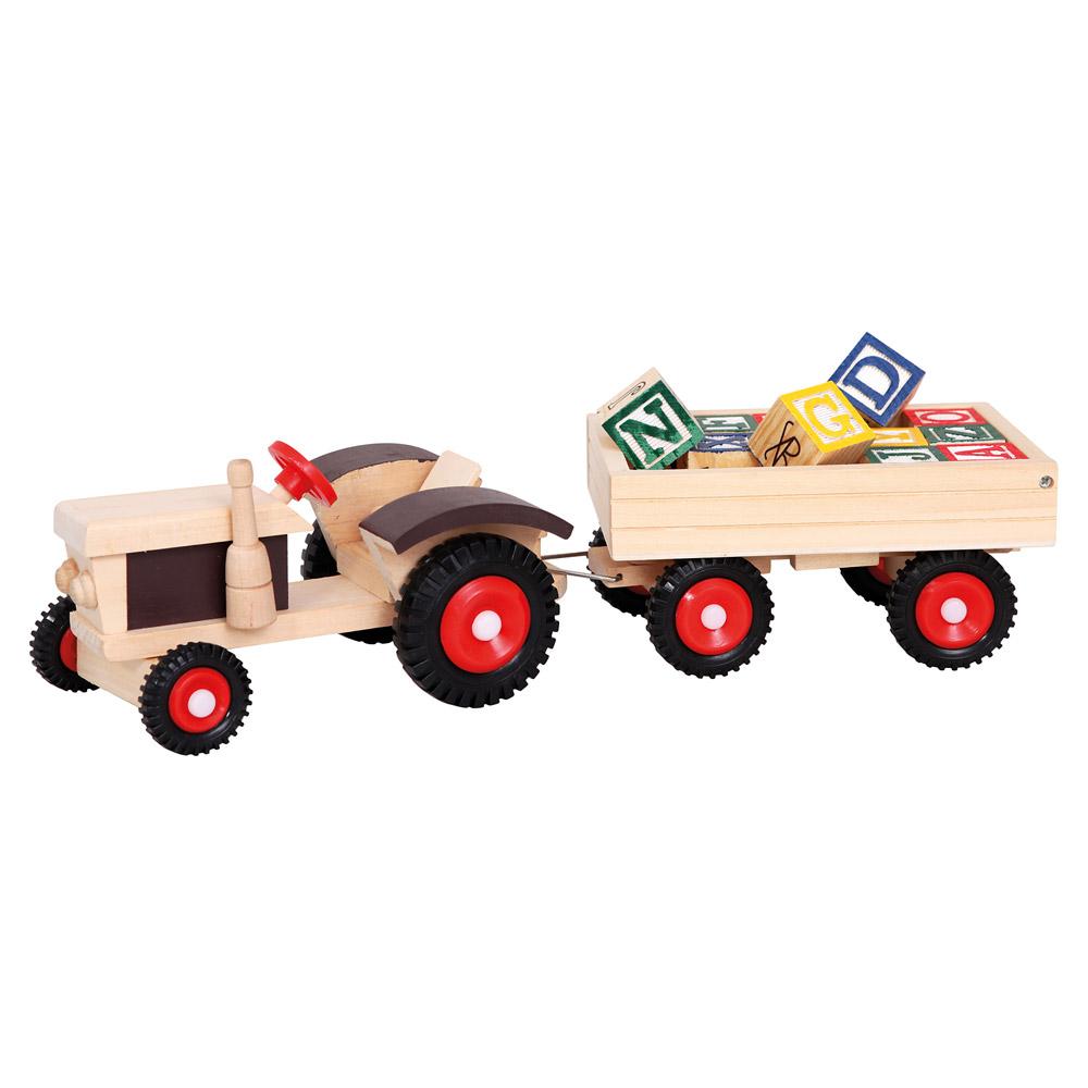 Traktor s gumovými koly a vlekem